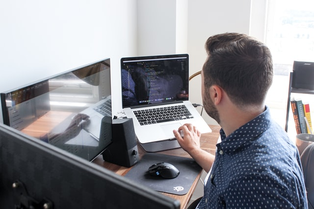 Man at computer thing about personlization in marketing